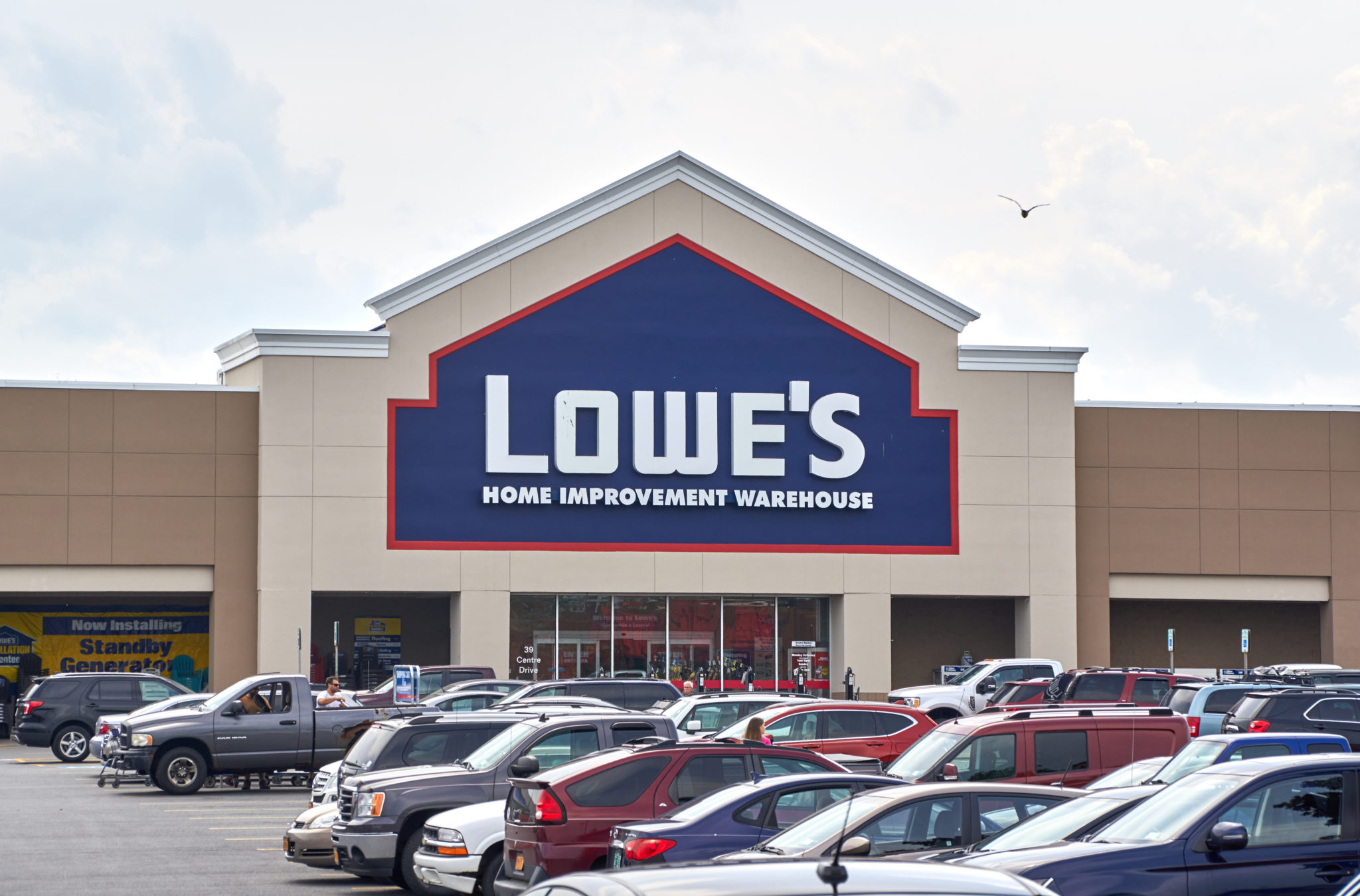 Lowes is a big box stores have plenty of mulch, shovels, rakes and lots of landscape supplies, grass, etc.